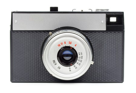 Classic 35mm film camera isolated on white
