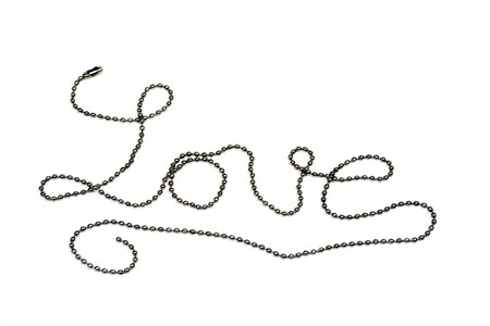 Metal beads making the word love isolated on white