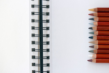 Blank Notebook and Colorful Pencils