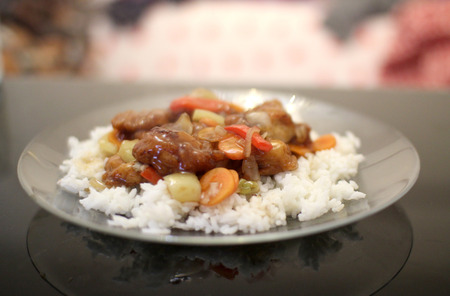 rice plate: Plate with asian style chicken and rice Stock Photo