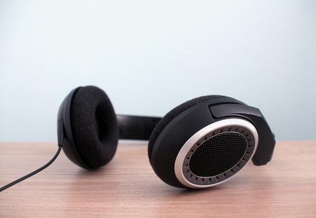 Modern audio headphones on table