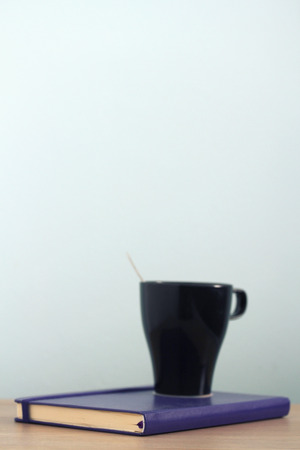 Black coffee cup on book
