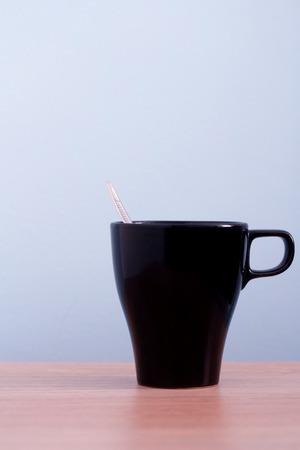 Empty black mug on desk