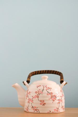 Asian style tea pot background Reklamní fotografie