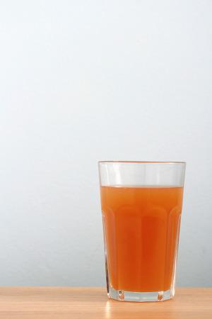 Organic Carrot Juice on  Desk Background Reklamní fotografie