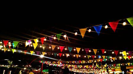 New Year fair. Fair in the city. Colorful pennant flags during the fair