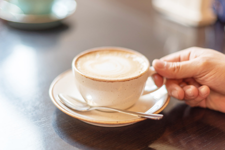 a man drinks coffee for breakfast