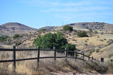 A semi-arid landscape just beyond sight of a fence