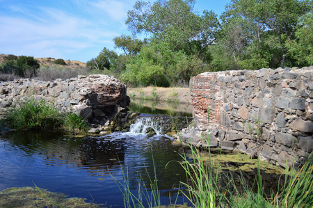 An old dam built on a river