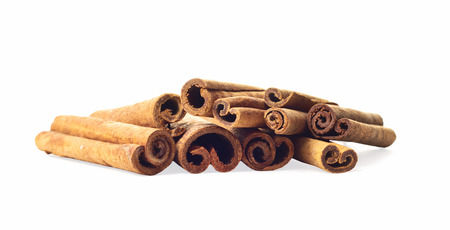 cannelle: Brown cinnamon sticks on white isolated background Stock Photo