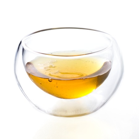 double glass: Double glass tea cup filled with green tea on isolated background