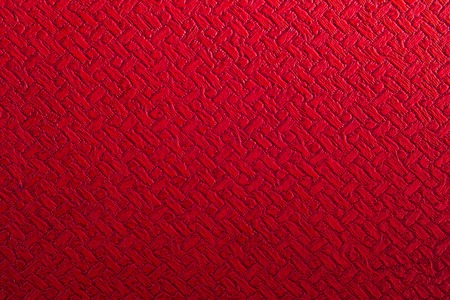 factitious: Nice warm red synthetic leather background texture