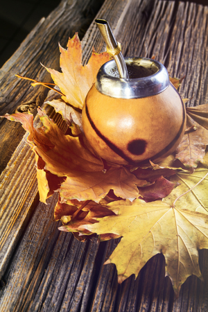 savour: Mate gourd on vintage wooden table close up Stock Photo