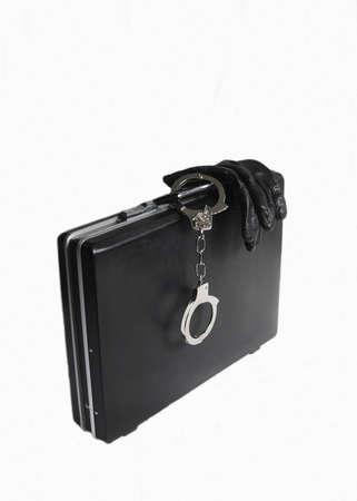 attache case: Attache case with black gloves and attached handcuffs on white