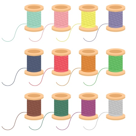 colored reels of thread on white background