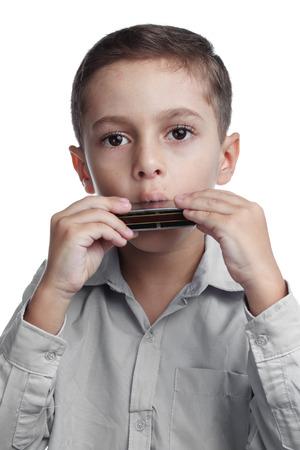 白い背景のハーモニカーを演奏する子供 写真素材