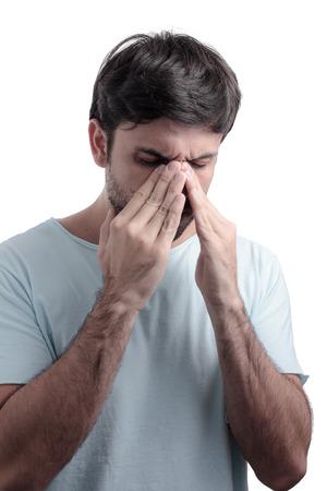 sinus: Sinus pain, sinus pressure, sinusitis. Sad man holding his nose because sinus pain Stock Photo