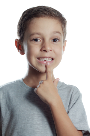 toothless: toothless smiling boy pointing his first tooth milk lost Stock Photo