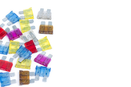 car fuse: Car fuse. Pile of colorful electrical automotive fuses or circuit breakers isolated on white background