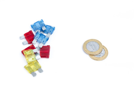 car fuse: Car fuse. brazilian currency and pile of colorful electrical automotive fuses or circuit breakers isolated on white background Stock Photo