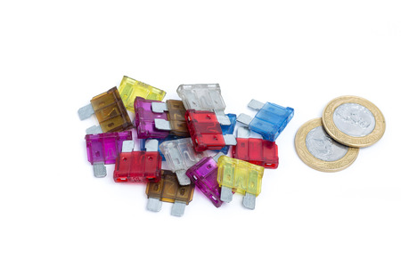 Car fuse. Pile of colorful electrical automotive fuses or circuit breakers isolated on white background