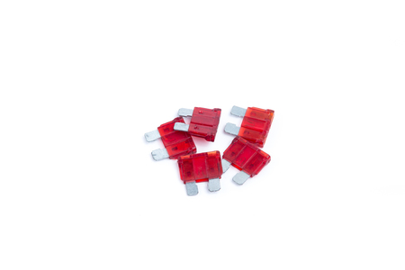 car fuse: Car fuse. Pile of red electrical automotive fuses or circuit breakers isolated on white background