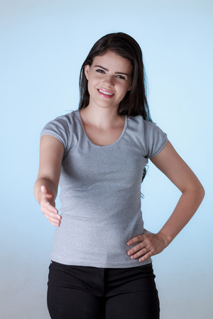 arm extended: Young business woman with arm extended for a handshake
