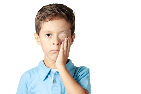 eye patch: Child with eye patch isolated on white background