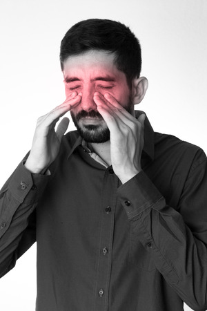 sinusitis: Sinus pain, sinus pressure, sinusitis. Sad man holding his nose because sinus pain Stock Photo