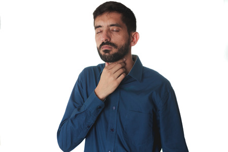 sore throat: Young man holding the neck. sore throat.
