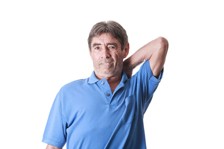 Portrait of senior man suffering with back pain on white background