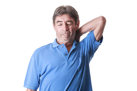 old man on a physical pressure: Portrait of senior man suffering with back pain on white background