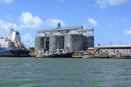 moored: Ships moored near silos in the Port of Cabedelo, Brazil