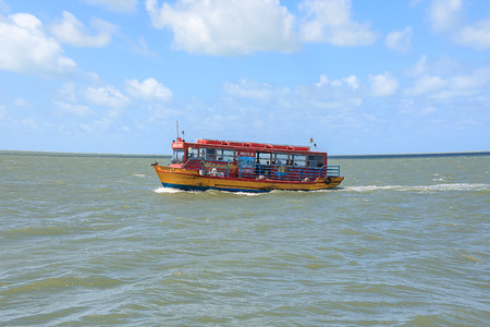 water bus: Cabedelo, Paraiba, Brazil - September 7, 2016 - Boat known as barcÃnibus on the Paraiba River. It is a carcass of a bus adapted to the boat.