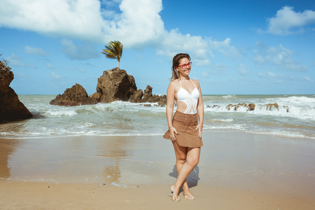 brazil beach swimsuit: Woman in Tambaba Beach in Brazil, known for allowing the practice of nudism  naturism