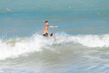 Cabedelo, Paraiba, Brazil - September 18, 2016 - Young man surfs in Intermares Beach Editorial