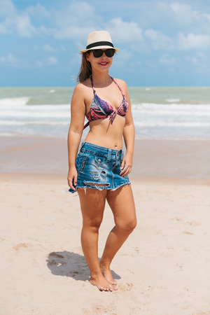 brazil beach swimsuit: Portrait of young woman wearing hat and bikini on the tropical beach Stock Photo