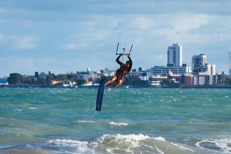 kiteboarding: Cabedelo, Paraiba, Brazil - November 26, 2016 - Man practices kitesurf on tropical beach Editorial