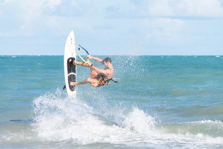 Cabedelo, Paraiba, Brazil - November 26, 2016 - Man practices kitesurf on tropical beach Editorial
