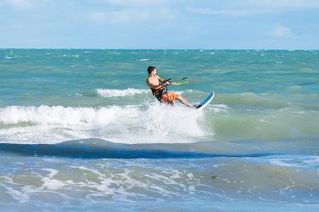 kitesurf: Cabedelo, Paraiba, Brazil - November 26, 2016 - Man practices kitesurf on tropical beach Editorial