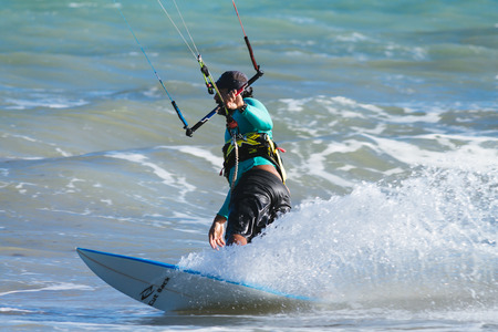wind surfing: Cabedelo, Paraiba, Brazil - November 26, 2016 - Man practices kitesurf on tropical beach Editorial