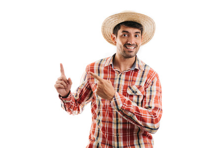 Portrait of brazilian man wearing typical clothes for the Festa Junina