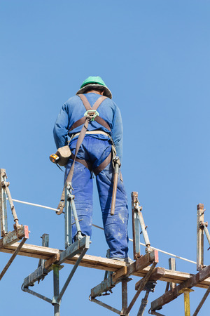 Construction worker working on top of construction site on a sunny day