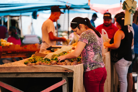 Picui, Paraiba, Brazil - June 3, 2017 - Woman shopping at the local Farmers market in Brazil Editorial
