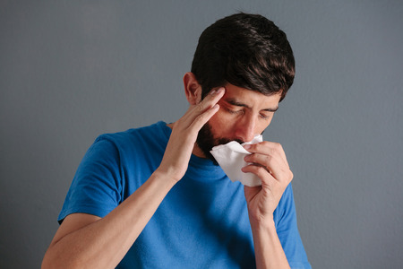 Sinus pain, sinus pressure, sinusitis. Sad man holding his nose because sinus pain Reklamní fotografie
