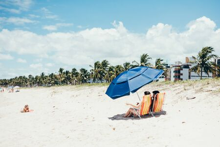 Cabedelo, Paraiba, Brazil - February 24, 2017 - People relax on the beach on sunny summer day