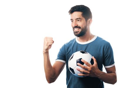 Fan or sport player on blue uniform celebrating on white background 스톡 콘텐츠