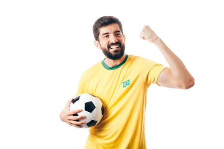 Brazilian soccer player celebrates on white background Archivio Fotografico