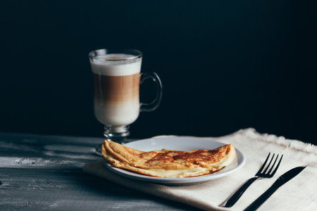 Crepioca - pancake of cassava (tapioca) with cheese on plate on wooden background. Selective focus 写真素材
