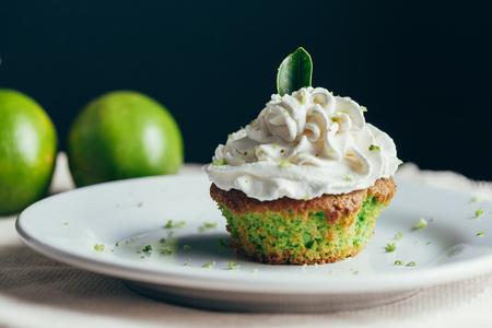 Lime cupcake with lemon cream, selective focus